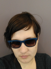 a nerd trying to look really cool with sunglasses